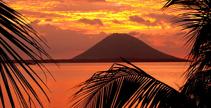 Sunset over Manado Tua Volcano as viewed from Kima Bajo Resort - copyright Ken Knezick, Island Dreams